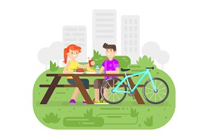 Cyclist couple on picnic