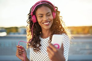 Attractive woman listening to music on her mobile