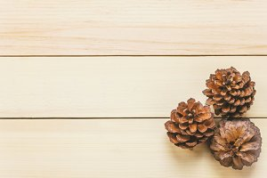 Top view pine cones on wooden.