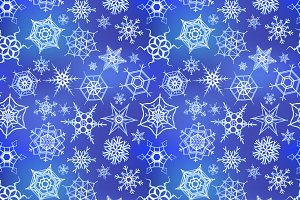 A lot of frozen snowflakes on blue