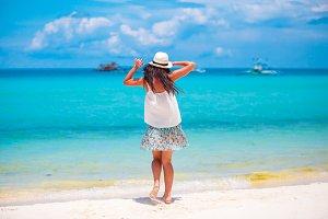 Happy beautiful girl enjoying beach tropical vacation