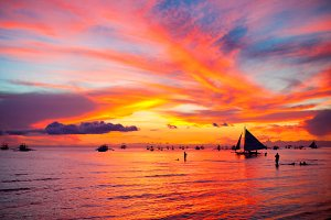 Sailing boat at beautiful colorful sunset