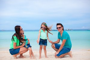 Young happy family on beach vacation in Asia