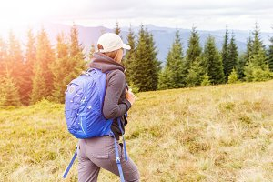 Young backpacker woman enjoying mountain trip