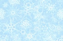 Frozen snowflakes on ice background