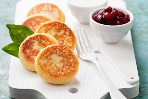 Cottage cheese pancakes Russian syrniki, selective focus