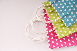 Three bags colored with circles top