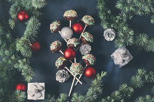 Christmas tree branches with cake pops and baubles