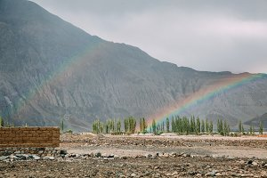 two rainbows after raining in highland mountain area in Leh, India