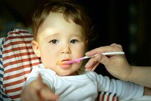 Baby eats porridge