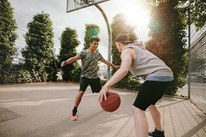 Young friends playing basketball