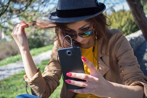 Hipster girl with smartphone