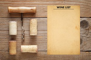 Corkscrew with corks and wine list