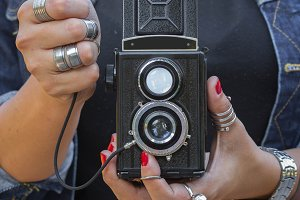 Girl holding vintage film camera