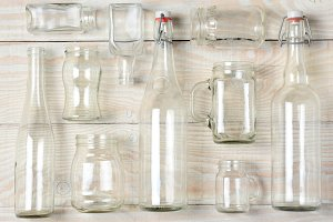 Assorted Clear Glass Bottles on Whit