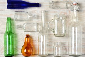 Assorted Glass Bottles on White Wood