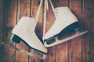 Ice skates on wooden background