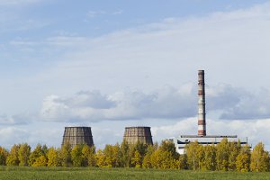 Autumn scenery on the background of power plant