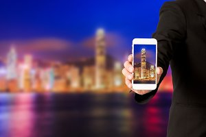 Business man use smartphone on city