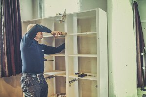 Carpenter building a bookcase