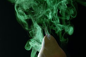 green pear enveloped by green smoke