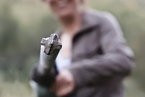 Woman holding hammer drill