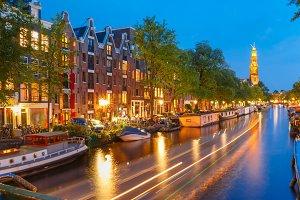 Night Amsterdam canal and Westerkerk church