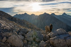 Male hiker in mountains at sunrise