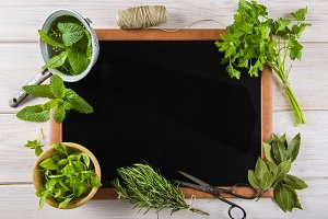 Blackboard surrounded by herbs and spices