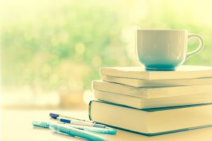 White coffee cup and  books stacking