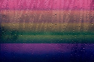 Droplet on window with Rainbow Color