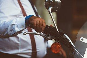 Man holding moto handle