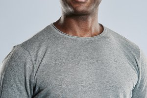 Fit handsome smiling man in gray shirt