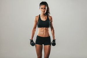 Strong woman with weights