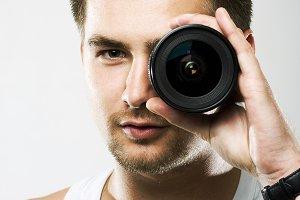 man looking throw camera lens