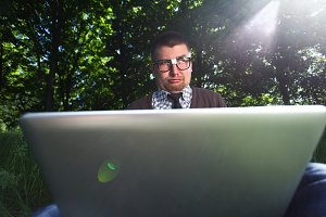 man in glasses with a laptop