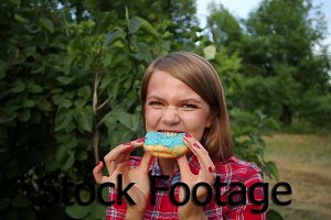 Girl eats donut