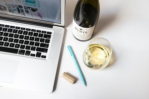 Wine + Laptop on Clean Desk