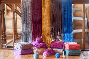 collection of colorful knit scarfs