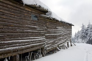 Wooden house in winter mountain.