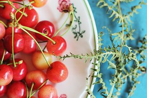 Fresh cherries in a vintage dish
