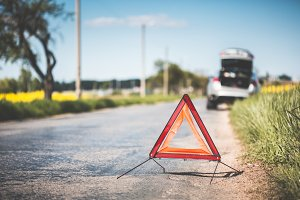 Red Warning Triangle and Broken Car