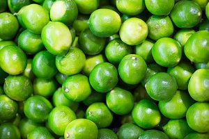 Pile of Green Limes on Market