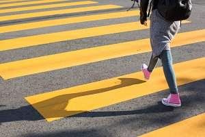 Young Girl Crossing a Street