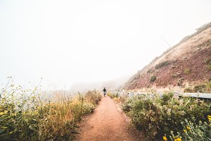 Woman Hiking the Mountain Trail