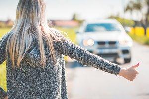 Blonde Woman Hitchhiking Broken Car