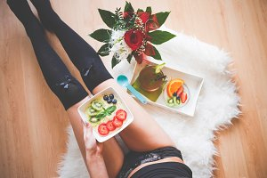 Woman with Fresh & Healthy Breakfast