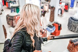 Blonde Girl Shopping at the Store