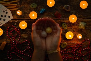 fortuneteller holds crystal balls