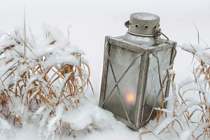 Old lantern with a candle